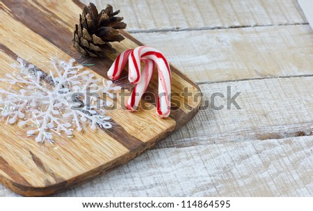 Traditional christmas candy can and pine cone on wooden background