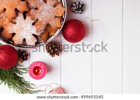 Traditional Christmas cookies in a tin box, top view #499693540