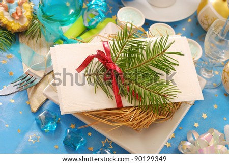 traditional christmas eve wafer on plate with hay on festive table