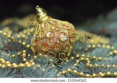 Traditional christmas or new year decorated tree with a golden toy