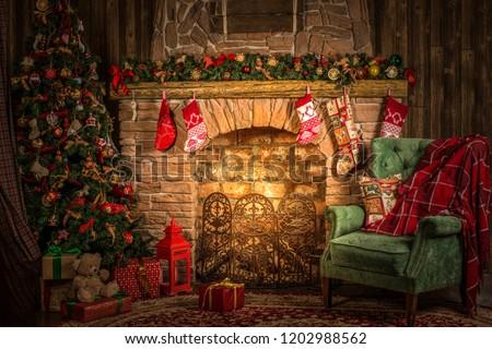 Traditional Christmas room, fireplace, armchair and Christmas tree