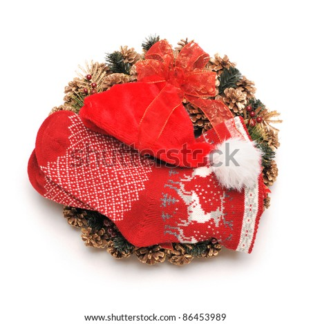 Traditional christmas wreath with santa hat an stocking isolated on white