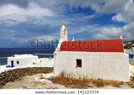 Traditional church and houses at Mykonos island in Greece