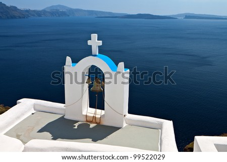 Traditional church and steeple at Oia village of Santorini island in Greece