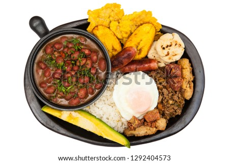 Traditional Colombian dish called Banda paisa: a plate typical of Medellin that includes meat, beans, egg and plantain Foto stock ©