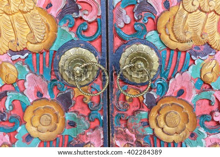 Traditional Colorful Balinese Style Door Knob, made of bronze, in Ubud, Bali, Indonesia.