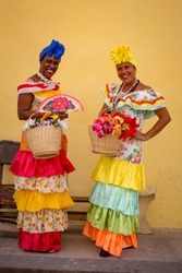 Traditional colorful cuban costumes worn by Havana ladies