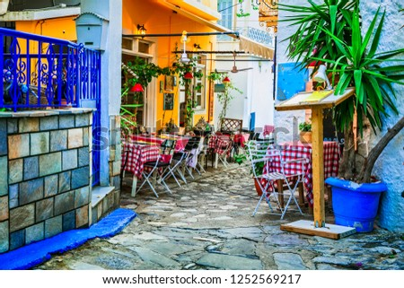traditional colorful Greece series - cute taverns in narrow streets. Skiathos island