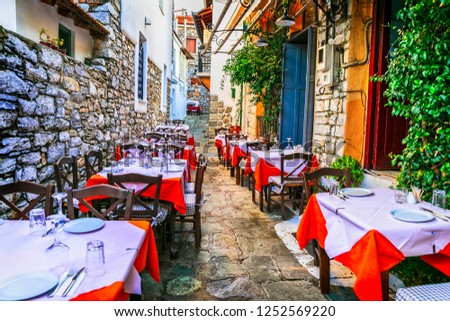 traditional colorful Greece series - cute taverns in narrow streets, Skiathos island