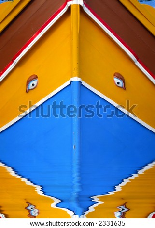 Traditional colours and decor on a Malta fishing boat, or luzzu. The eyes have been used since Phoenician and Egyptian times, believed to cast off evil spirits