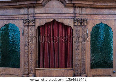 Traditional confessional to take away his sins
