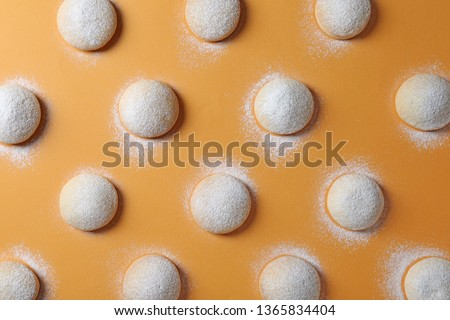 Traditional cookies for Islamic holidays on color background, flat lay. Eid Mubarak