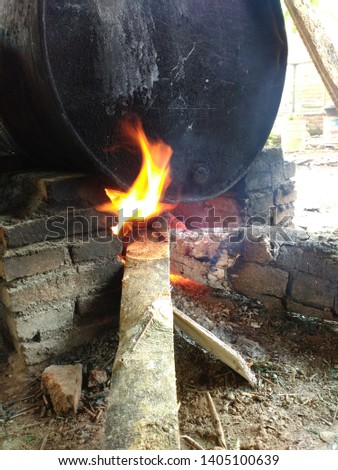 traditional cooking with stoves and firewood ,  traditional cooking with stoves and firewood   #1405100639