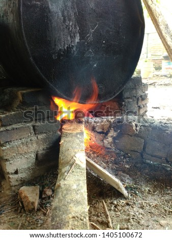 traditional cooking with stoves and firewood ,  traditional cooking with stoves and firewood   #1405100672
