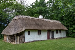 Traditional country house with thatched roof. Rural theme. Frilandsmuseet, Denmark.