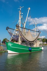 Traditional crab cutter is located in the port of Fedderwardersiel