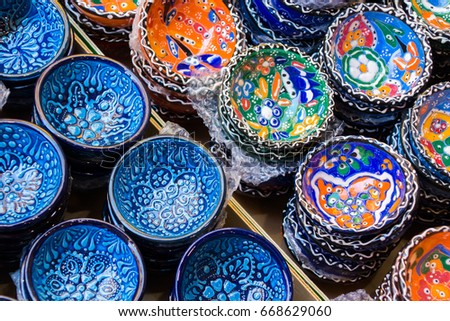 Traditional Cretan painted ceramic dishes for sale at a city centre shop along Odos 1821, Heraklion, Crete, Greece, Europe.
