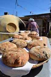 Traditional Cypriot bread with halloumi and black olive baked in a stone oven in the village garden.