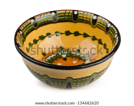 Traditional decorated balkan ceramic bowl isolated on white