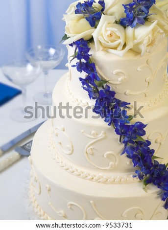 stock photo traditional decorated wedding cake with blue delphiniums and