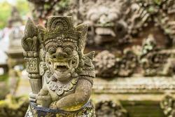 Traditional demon guards statue in Bali island.