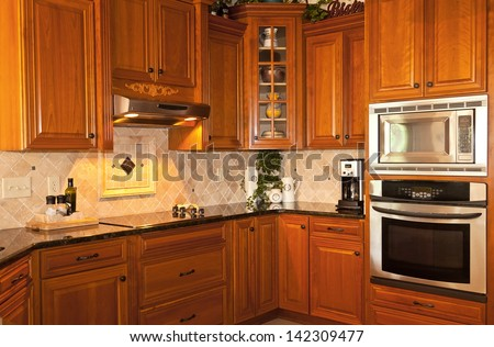 Traditional Designed Kitchen With Wooden Cabinets And Granite