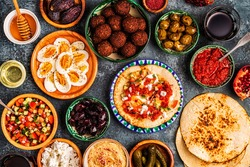Traditional dishes of Israeli and Middle Eastern cuisine -malavach with different fillings, top view.