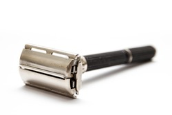 Traditional double edge safety razor isolated on white background