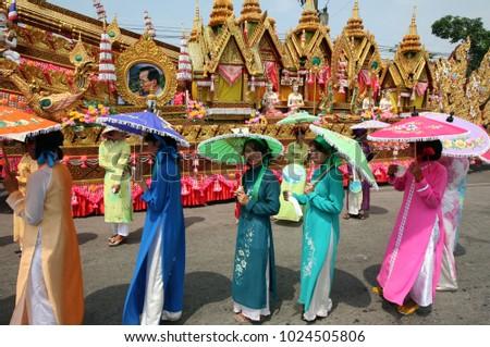 traditional dress women at the rocket festival or Bun Bang Fai in Yasothon in Isan in north east Thailand.    Thailand, Yasothon, May, 2012 #1024505806