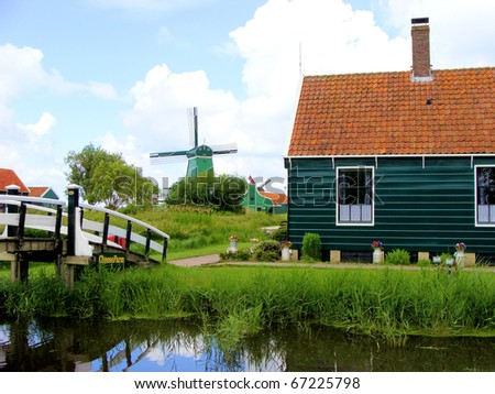 Traditional Dutch country scene with windmill in the background