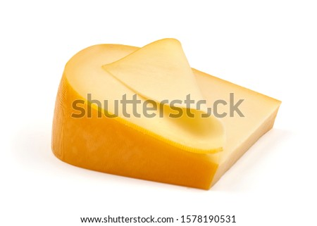 Traditional Dutch Gouda cheese, isolated on white background.