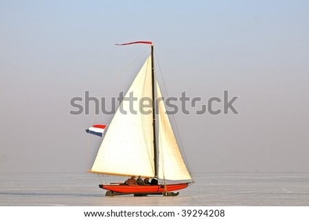 Traditional dutch: Ice sailing on a cold winter day on the Gouwzee in the Netherlands