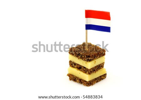 traditional dutch layered rye bread and cheese snack with Dutch  flag toothpick isolated on white