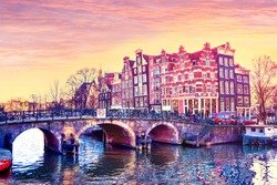 Traditional Dutch old houses on the canals in Amsterdam at sunset, The Netherland. Travel background with retro vintage instagram filter