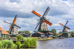 Traditional Dutch old wooden windmill in Zaanse Schans - museum village in Zaandam. The Netherlands.