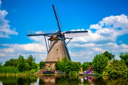 Traditional Dutch windmill at Kinderdijk on a sunny summer day. Kinderdijk windmills are a UNESCO world heritage site in the Netherlands.