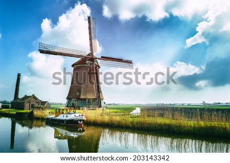 Traditional dutch windmill near the canal. Netherlands Stock photo ©