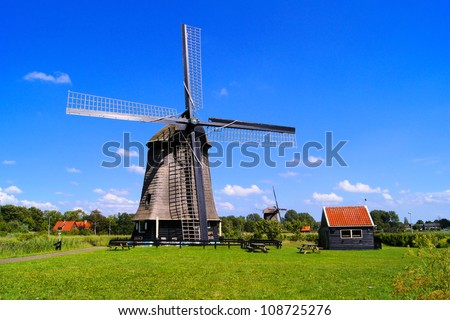 Traditional Dutch windmill under blue skies near Alkmaar, The Netherlands
