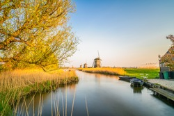 Traditional Dutch windmills at sunset in Netherlands