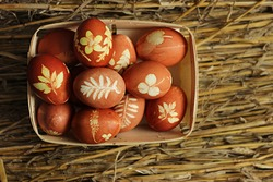 Traditional easter eggs dyed in onion peel.  Light Easter holiday. Religious traditions. Easter eggs on a straw.