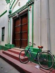 traditional elephant blocking door and antique bicycle in the doorway