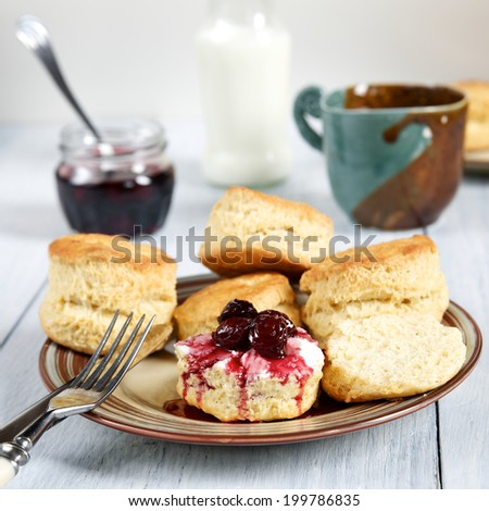 Traditional English baking - scones with tea, milk and jam Stock photo ©