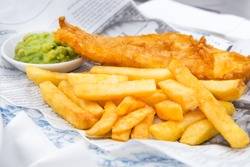 Traditional English Food such as Fish and Chips with mushy peas served in the Pub or Restaurant