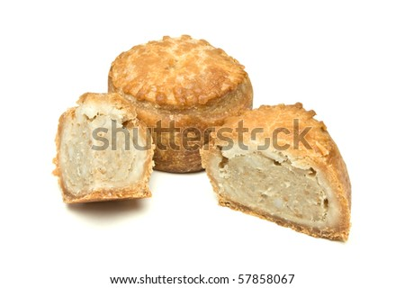 Traditional English Pork Pie from low perspective isolated against white background.