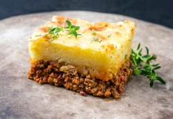 Traditional English shepherd pie offered as closeup in a rustic modern design plate