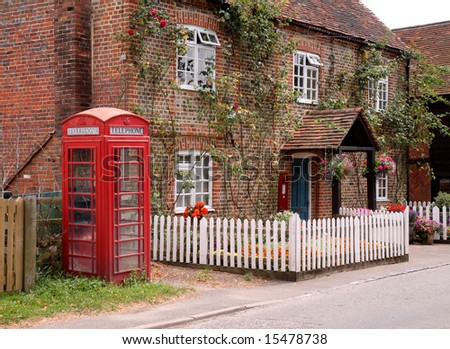 stock-photo-traditional-english-village-post-office-with-garden-picket-fence-and-telephone-box-15478738.jpg