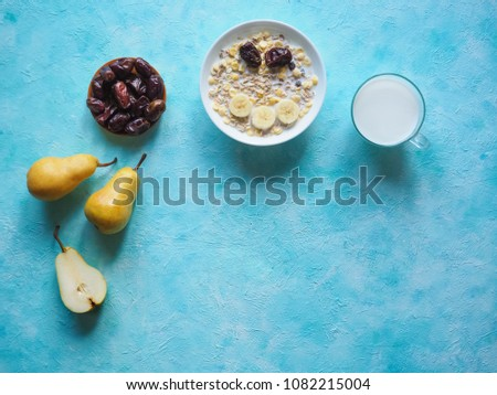 Traditional european breakfast. Milk and granola. Muesli, dates and fresh pears #1082215004