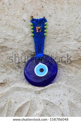 Traditional Evil Eye hanging over a doorway in Turkey