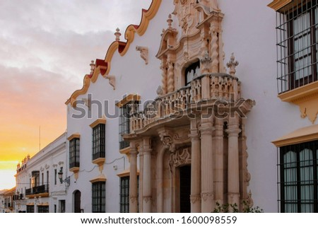 Traditional facades of houses with twisted forged balconies, Andalusia Spain