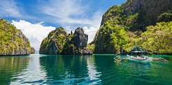 Traditional filipino boat in the sea panorama, Palawan island in Philippines